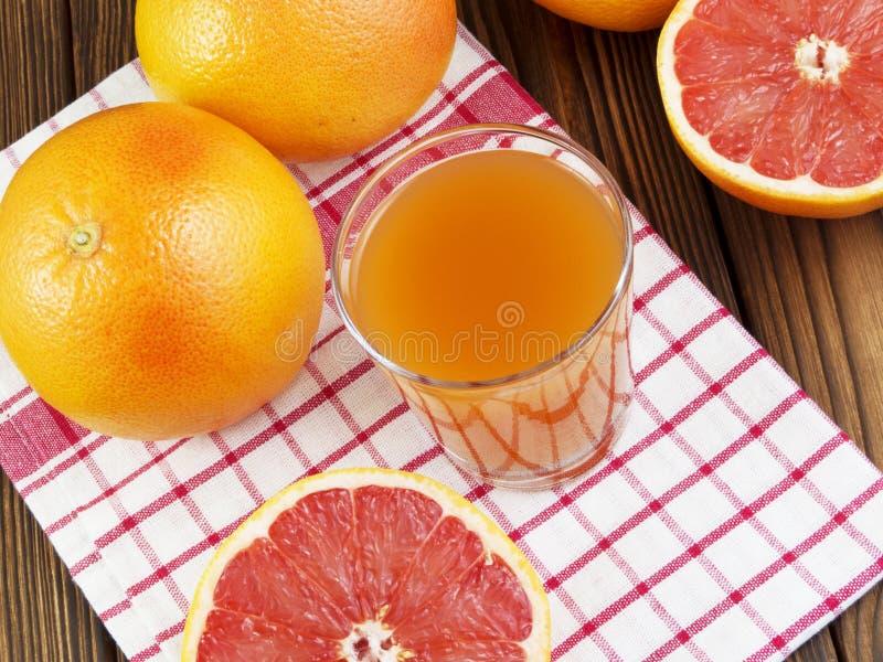 Grapefruit juice in glass stock image
