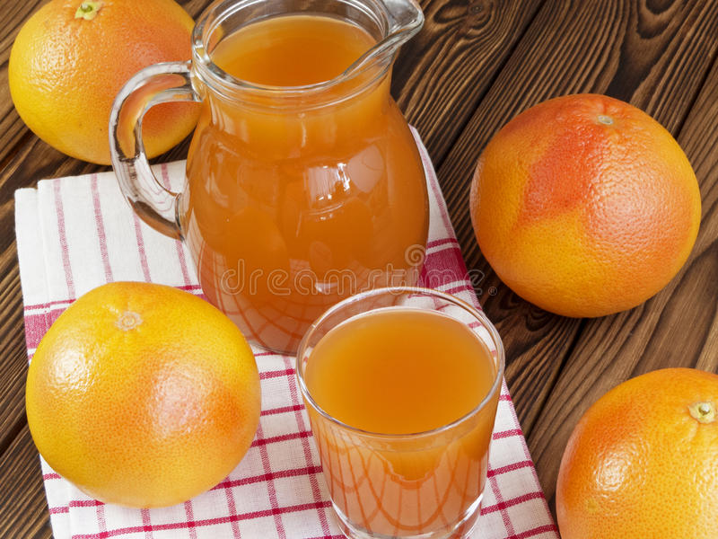 Grapefruit juice in glass stock photography