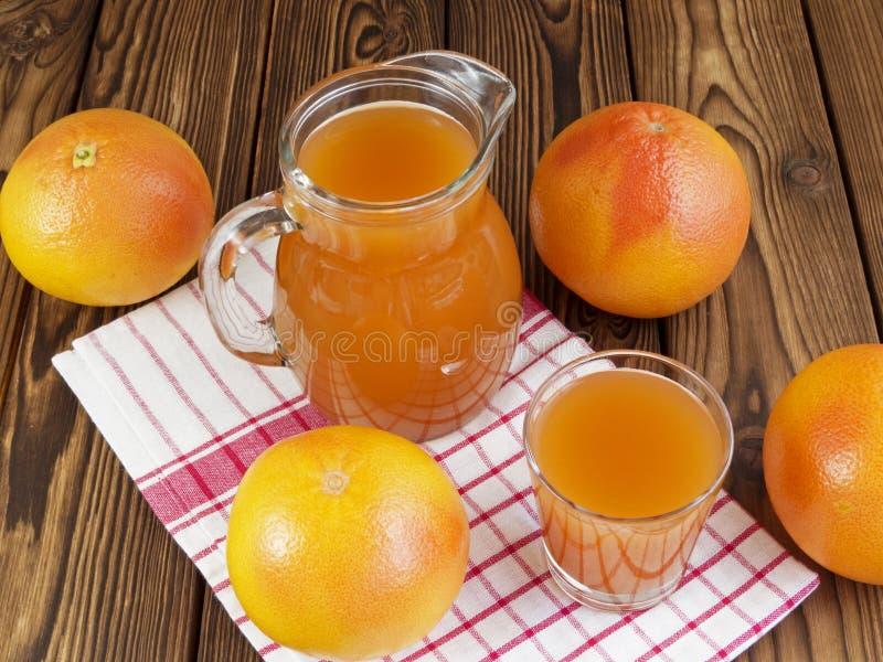 Grapefruit juice in glass royalty free stock photos