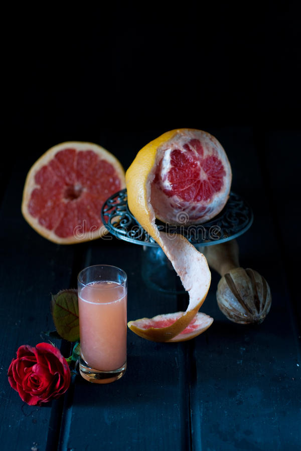 Grapefruit juice. Still life photography - grapefruit juice royalty free stock photo
