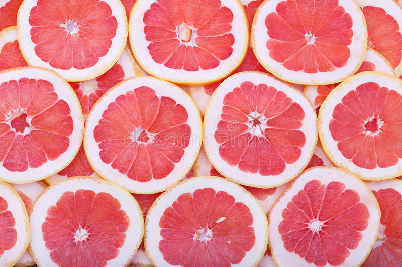 Grapefruit rings as background stock photography
