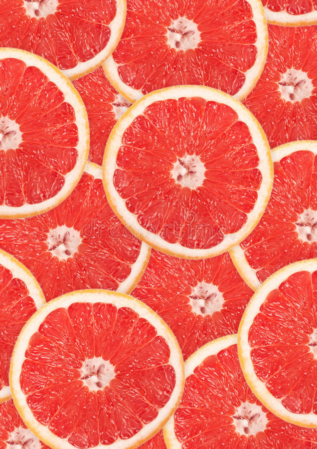 Grapefruit with slice detail stock photography