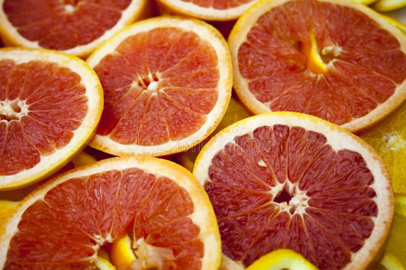 Grapefruit slices background texture. stock images