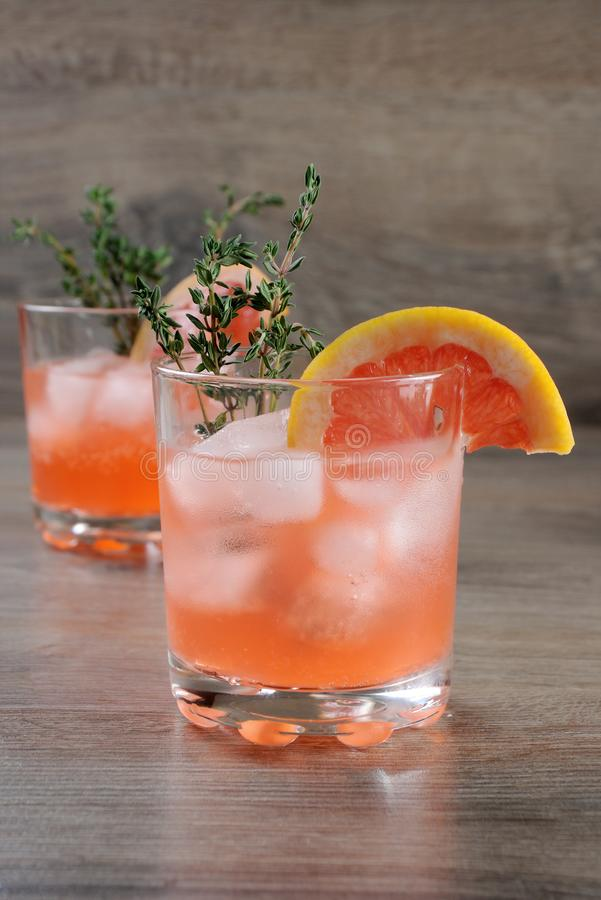 This Grapefruit and Thyme Bourbon. Muddled lime and thyme, combined with fresh grapefruit juice and delicious bourbon, it's the perfect сocktail . This stock images