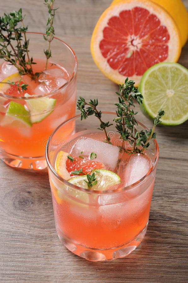 This Grapefruit and Thyme Bourbon. Muddled lime and thyme, combined with fresh grapefruit juice and delicious bourbon, it's the perfect way to get the stock images