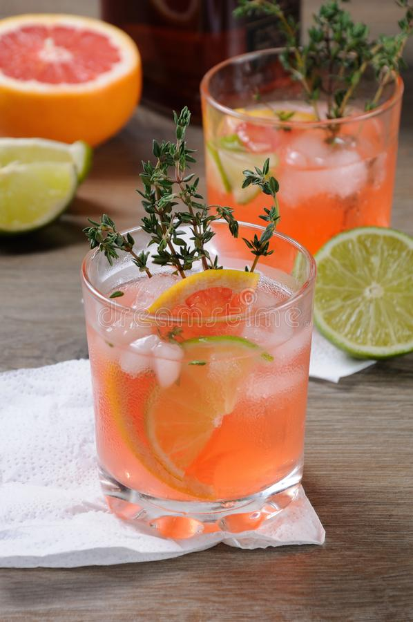This Grapefruit and Thyme Bourbon. Muddled lime and thyme, combined with fresh grapefruit juice and delicious bourbon, it's the perfect way to get the stock image