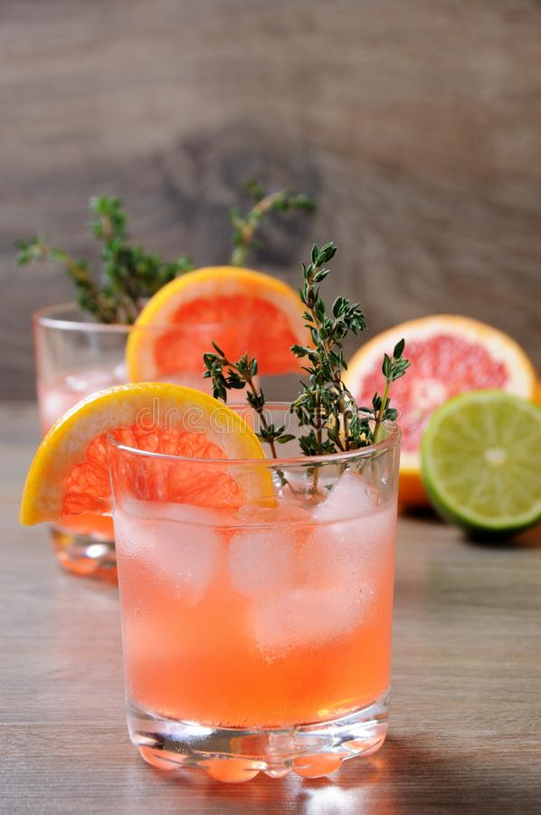 This Grapefruit and Thyme Bourbon. Muddled lime and thyme, combined with fresh grapefruit juice and delicious bourbon, it's the perfect way to get the royalty free stock photography