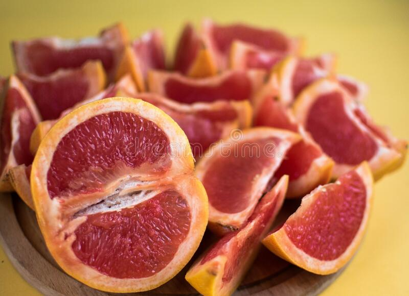Grapefruit is a tropical fruit that is a hybrid of litter and orange. It is a good source of vitamin C, a number of antioxidants a. Gainst viruses,Grapefruit cut stock images