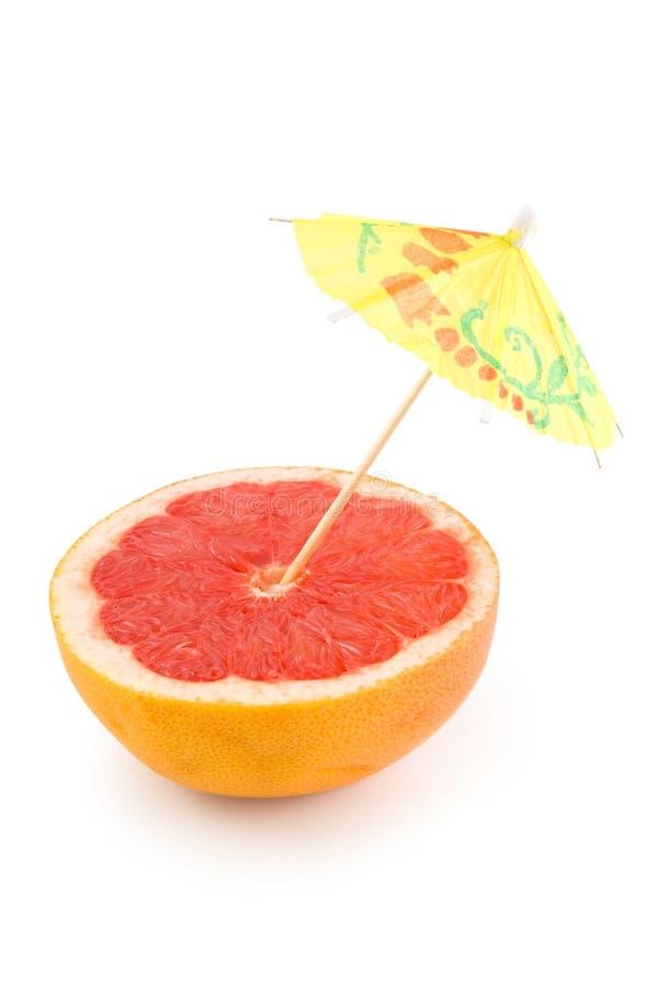 Grapefruit and umbrella stock image