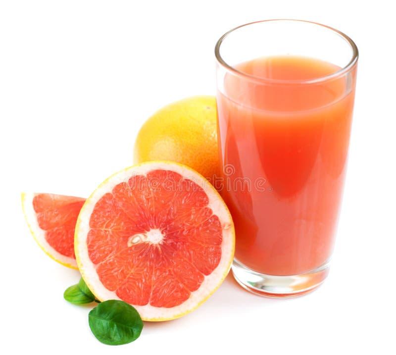 Grapefruitowy sok i dojrzali grapefruits obrazy stock
