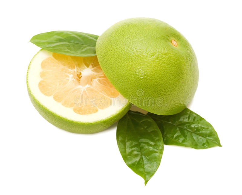 Grapefruits with green leafs. Fresh juicy grapefruits with green leafs stock images