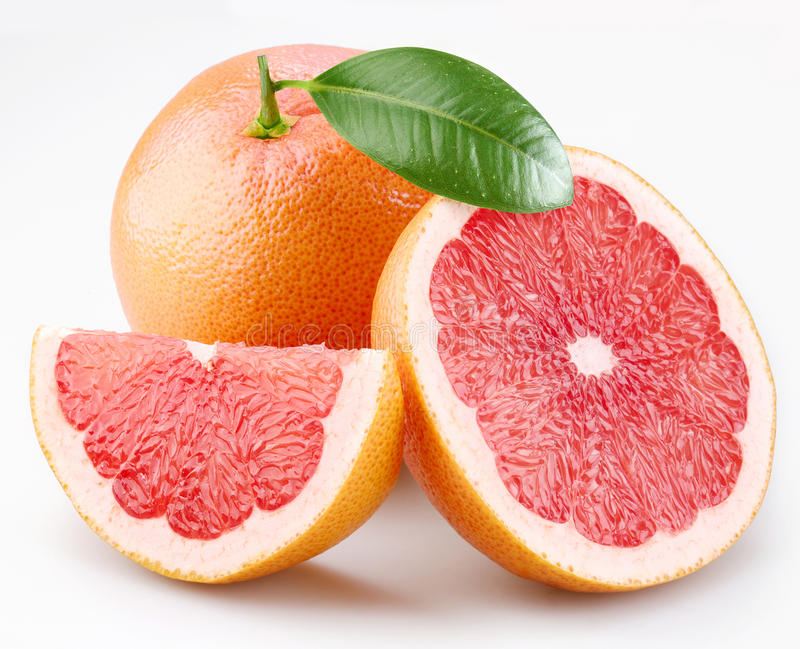Grapefruits and segments with a leaf royalty free stock images
