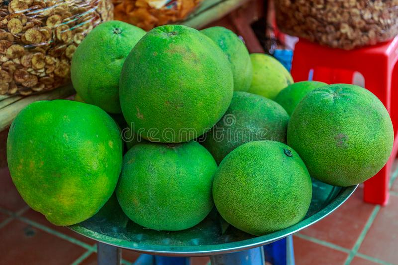 Grapefruits in Whole Displayed for Sale in a Marketplace in Cambodia royalty free stock photos