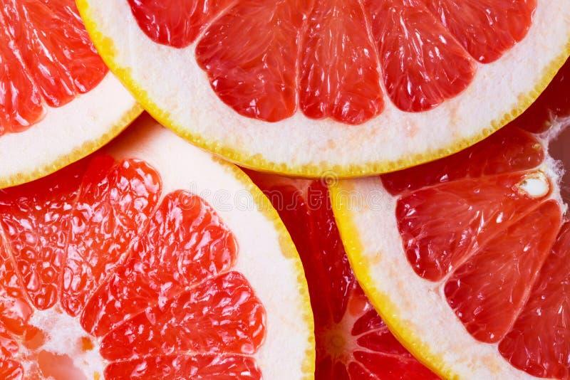 grapefruktbakgrunden arkivfoton