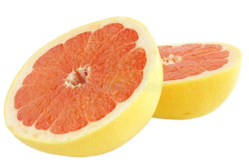 grapefrukthälfter fotografering för bildbyråer