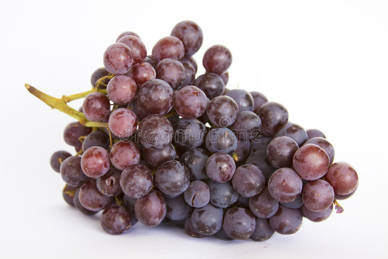 Grapes. A cluster of grapes on a white background