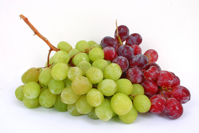 Grapes. A bunch of green and red grapes isolated in a white background