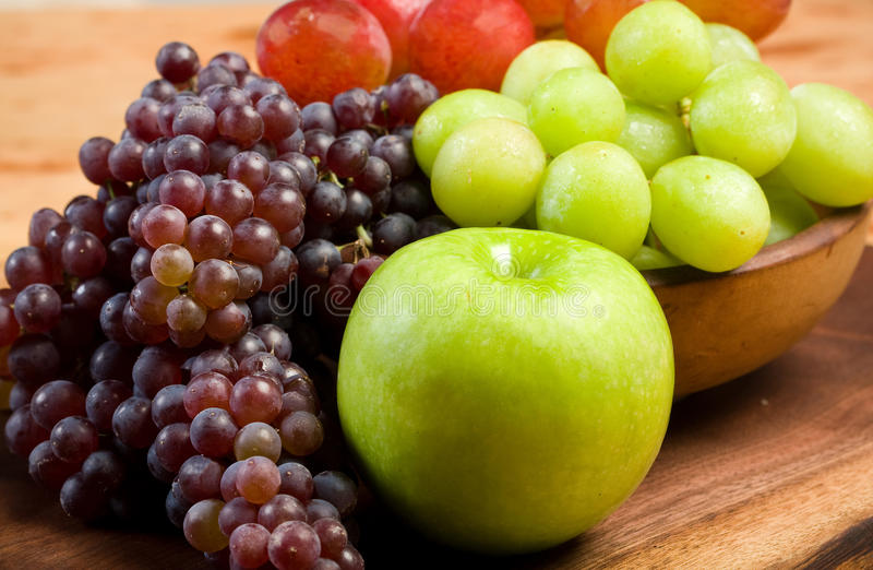 Download Grapes and Apple stock image. Image of cutting, bowl - 10403195