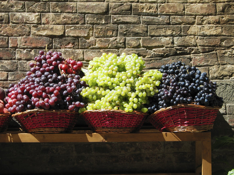 Grapes in baskets royalty free stock image
