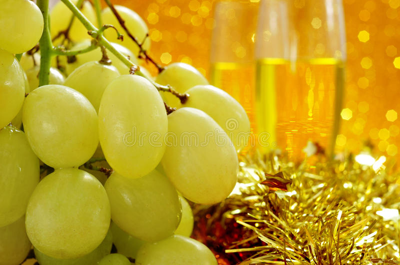 Grapes and champagne stock photos