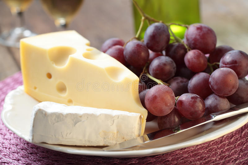 Grapes and cheese royalty free stock photos