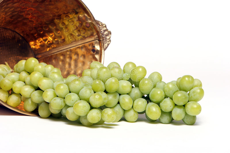 Grapes in a copper bucket royalty free stock photography