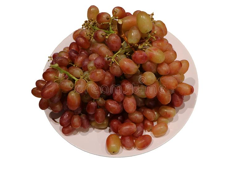 Grapes in a dish on a white background royalty free stock photos