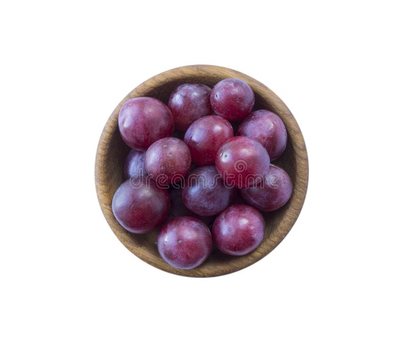 Grapes isolated on white background. Top view. Bunch of grape isolated on white background. Red grape isolated on the white backg. Round. Pink bunch grape stock image