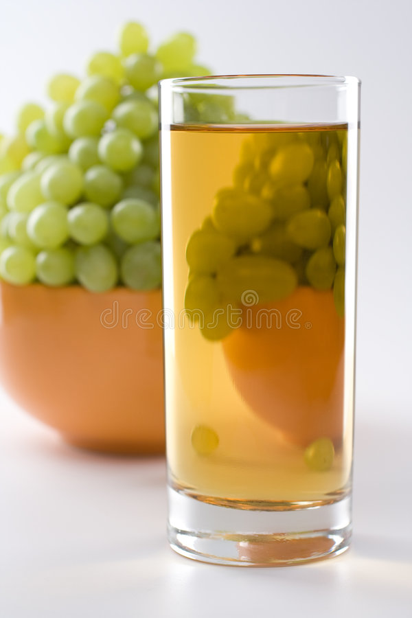 Grapes juice& grapes. Bunch of grapes with glass of juice royalty free stock photography