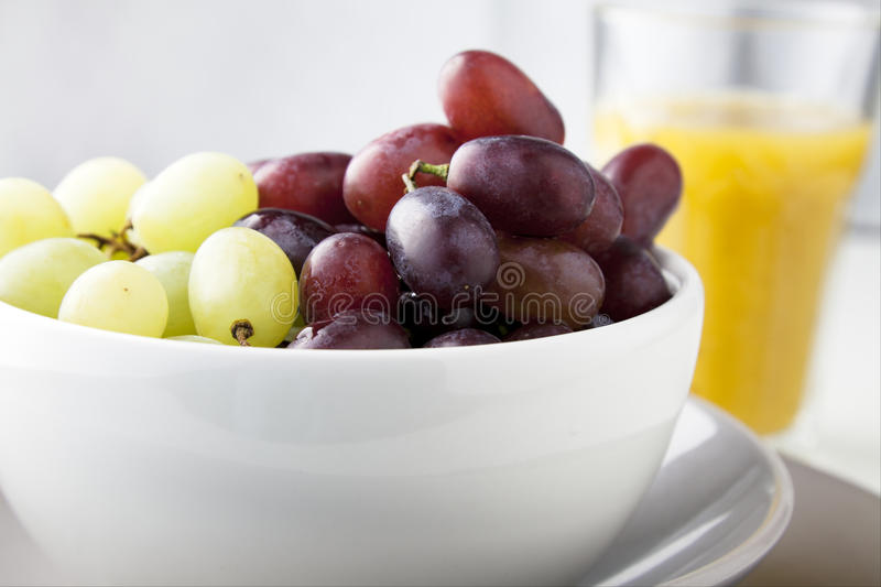 Grapes and Orange Juice stock photography