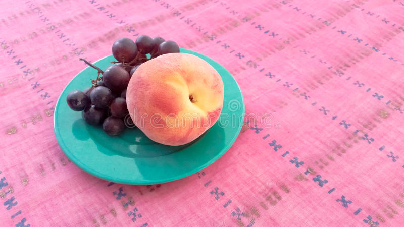 Grapes With Peach in a Plate. Grapes With Peach Served in a Plate stock image