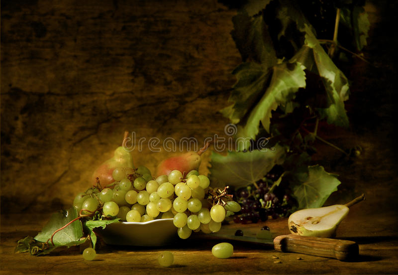 Grapes and pears on a dish royalty free stock photos