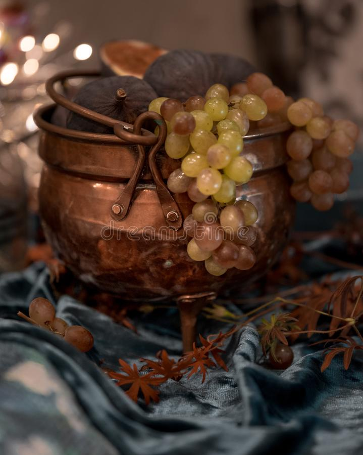 grapes vase closeup still life royalty free stock images