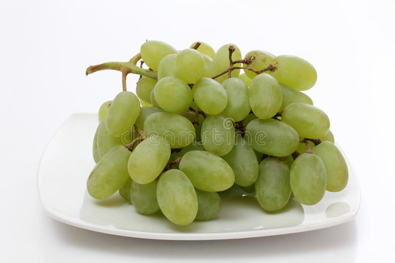 Grapes on white plate