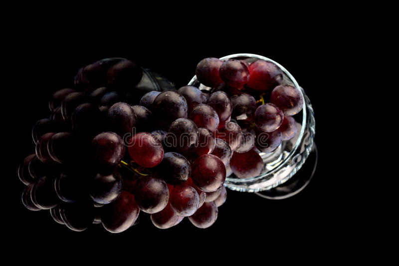 Grapes and wine glasses. Red o green grapes royalty free stock photography