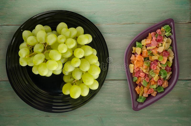 Grapes on a wooden background. grapes on a plate.  stock photo
