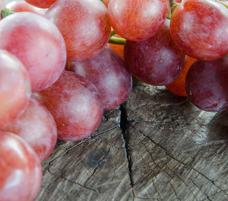 Grapes on a wooden table royalty free stock image