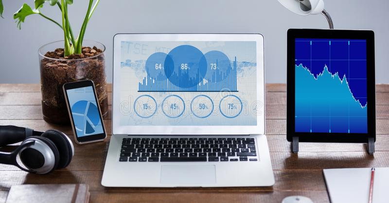 Graph chart screen on digital tablet, laptop and mobile phone. Kept on wooden table royalty free stock images