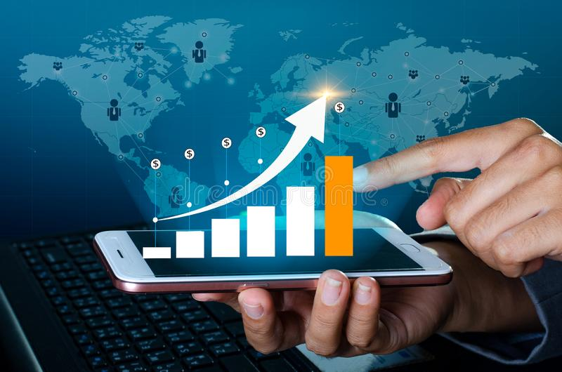 Graph of financial growth global communications Binary Smart Phones and world Internet Business people press the phone to communic. Ate in the Internet Stock royalty free stock images