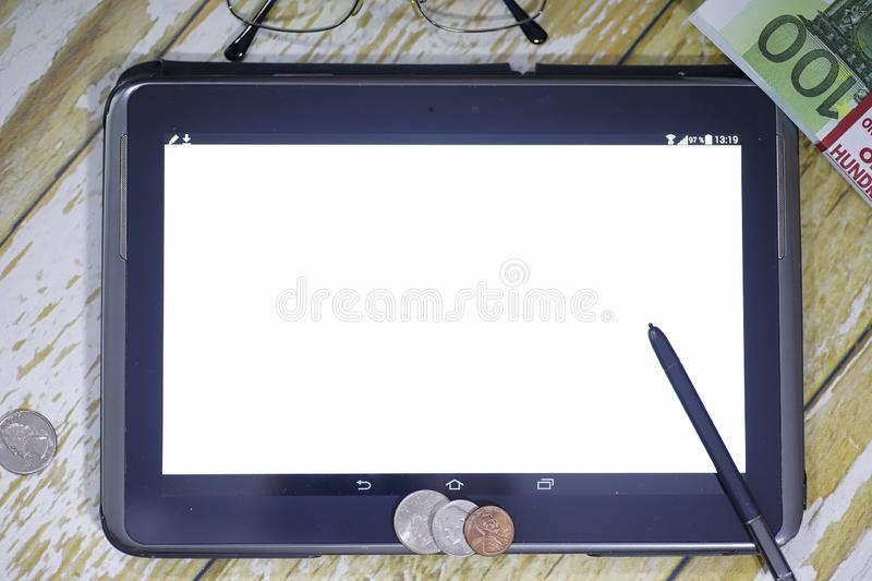The graph of income growth. Electronic tablet with a graph of gr. Owth rates of profit. The currency on the chart on the smartphone.r royalty free stock image