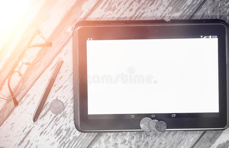 The graph of income growth. Electronic tablet with a graph of gr. Owth rates of profit. The currency on the chart on the smartphone.r stock image