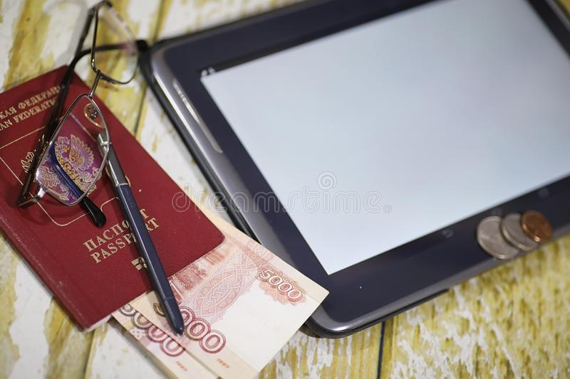 The graph of income growth. Electronic tablet with a graph of gr. Owth rates of profit. The currency on the chart on the smartphone.r royalty free stock photography