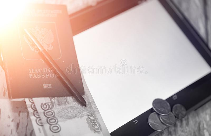 The graph of income growth. Electronic tablet with a graph of gr. Owth rates of profit. The currency on the chart on the smartphone.r stock photography