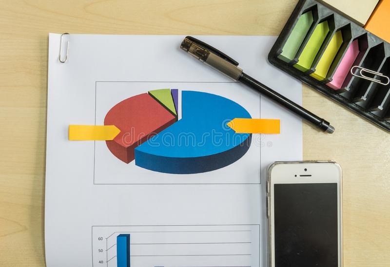 Graph of market share with black pen in business concept royalty free stock images