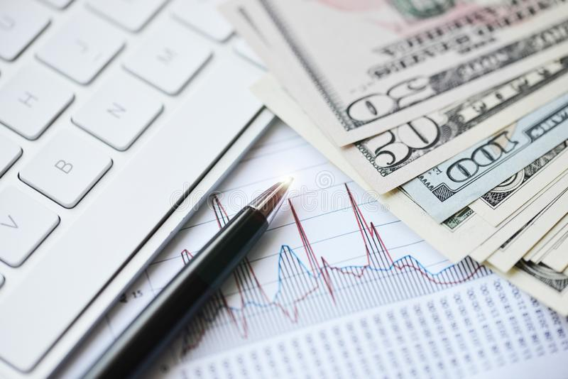 Graph with money and pen suggesting financial evolution royalty free stock photography