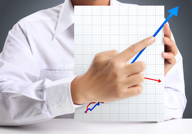 Graph of paper. In hand businessme stock photo