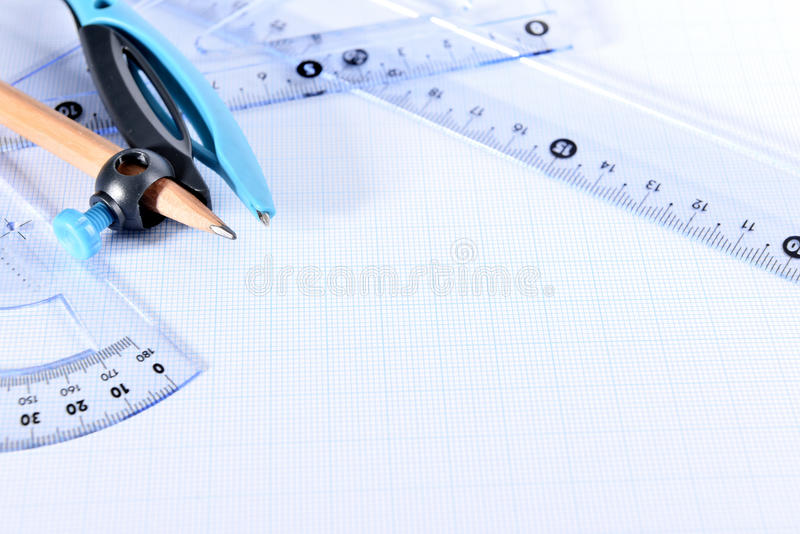 Graph paper. Closeup of drafting tools on graph paper royalty free stock photography