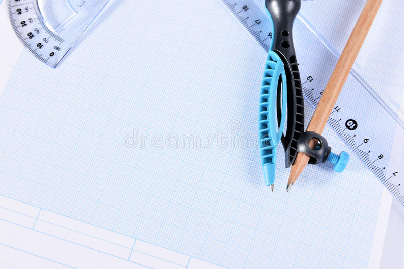 Graph paper. Closeup of drafting tools on graph paper royalty free stock photo