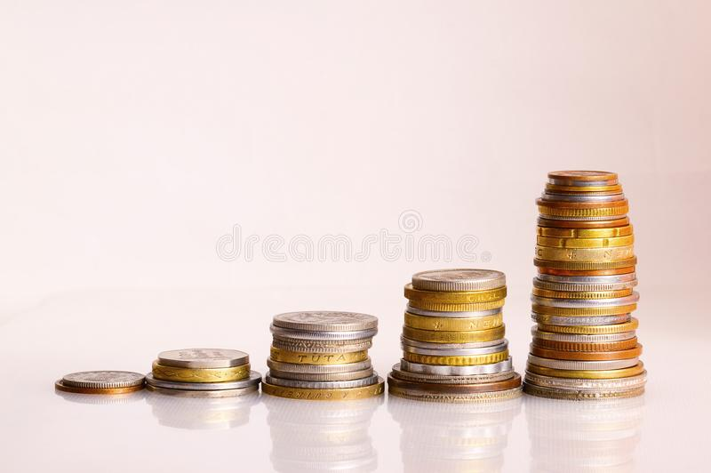 Graph rising with coins bars royalty free stock photos
