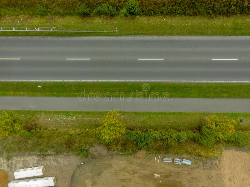 Graphic and abstract aerial view of the vertical photograph of a road with markings between fields. Germany stock images